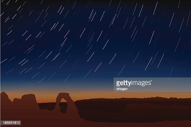 delicate arch with star trails - natural arch stock illustrations, clip art, cartoons, & icons