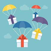 delivery service concept, gift box with colorful parachute suitable for Christmas or new year