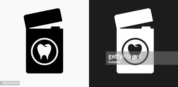 dental floss icon on black and white vector backgrounds - dental floss stock illustrations, clip art, cartoons, & icons