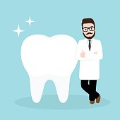 Dentist, doctor with a big healthy tooth