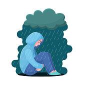 Depression, girl in hoodie sitting under rain