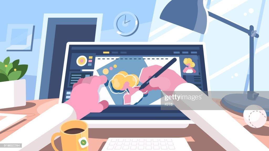 Designer illustrator draws on computer