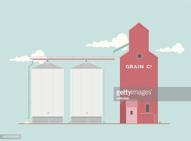 Diagram of a grain silo with clouds in the background