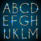 Diamond alphabet font with sparkles