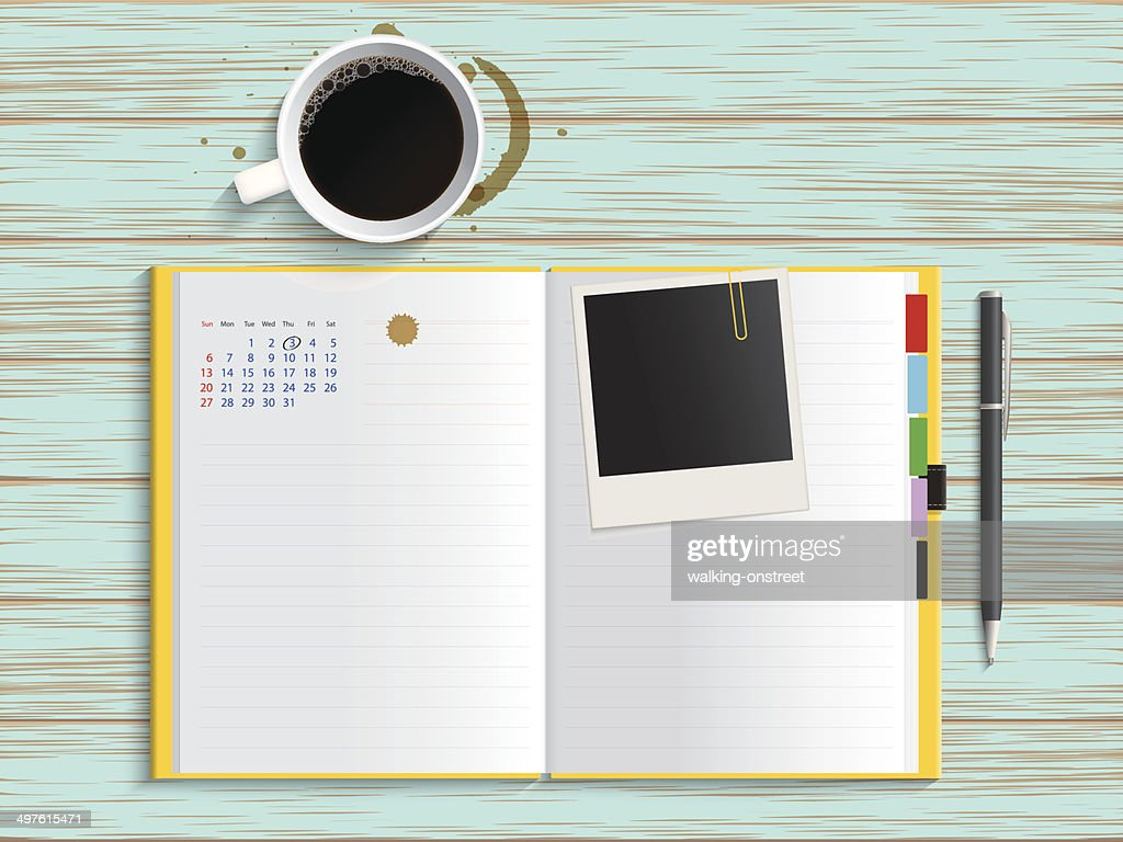 Diary with coffee on vintage table