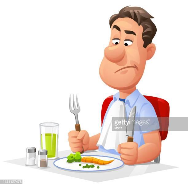 Dieting Man Eating Vegetables