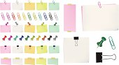 Different color post it notes, tacks and paper clips