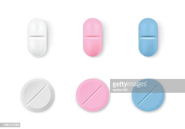 Different colored pills in a row