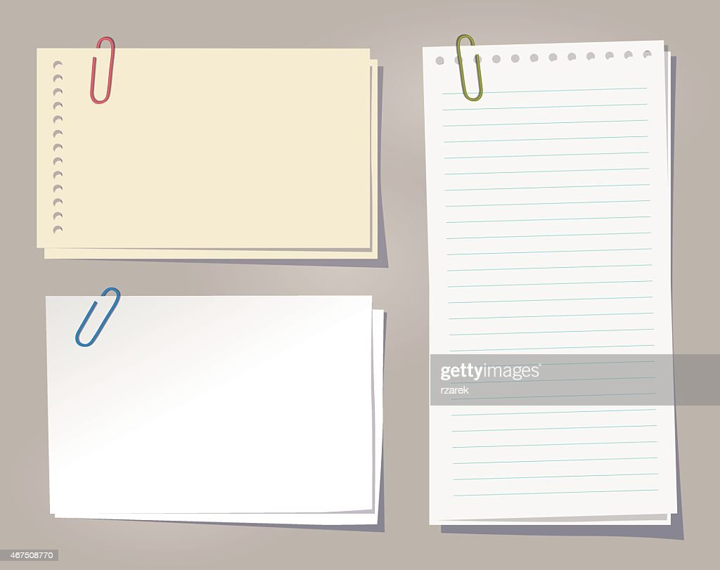 Different sheets of note papers and color paper clips.