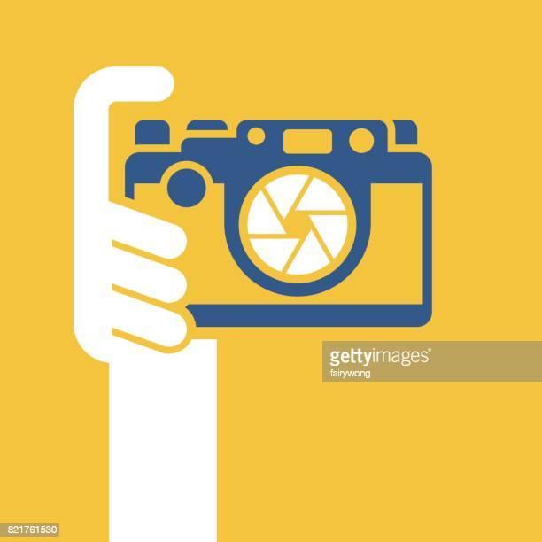 Digital camera in human hand