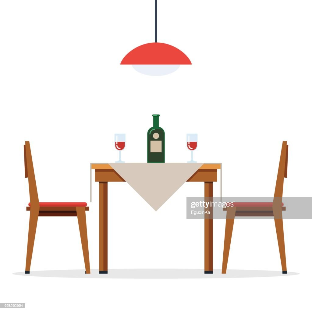 Dining table and chairs with wine