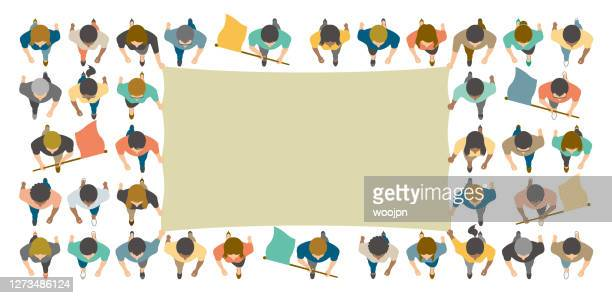 directly above view of crowd people walking with big blank flag on public demonstration or protest - protestor stock illustrations