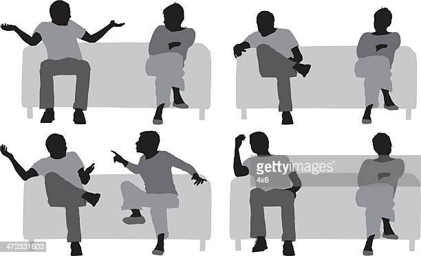 distracted couple sitting on a couch - ignoring stock illustrations, clip art, cartoons, & icons