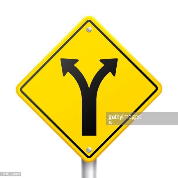 divergence traffic sign - partisan politics stock illustrations