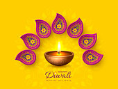 Diwali festival holiday design with paper cut style of Indian Rangoli and diya - oil lamp. Purple color on yellow background, vector illustration.