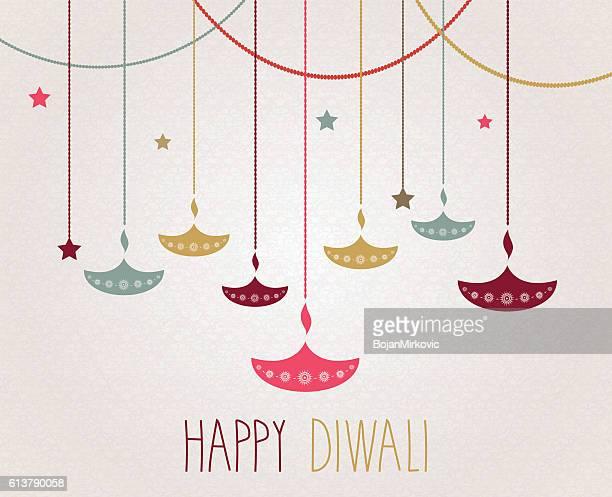 diwali. hanging colorful diya. handwritten text - diwali stock illustrations