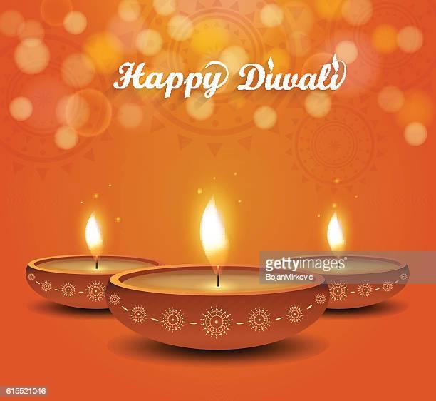diwali poster on orange background with burning diya - diwali stock illustrations