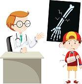 Doctor explaining x-ray film to boy
