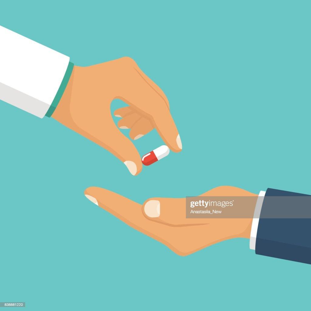 Doctor giving pills patient.