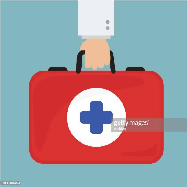 ilustraciones, imágenes clip art, dibujos animados e iconos de stock de mano de doctor con maletín profesional de la salud - maletín
