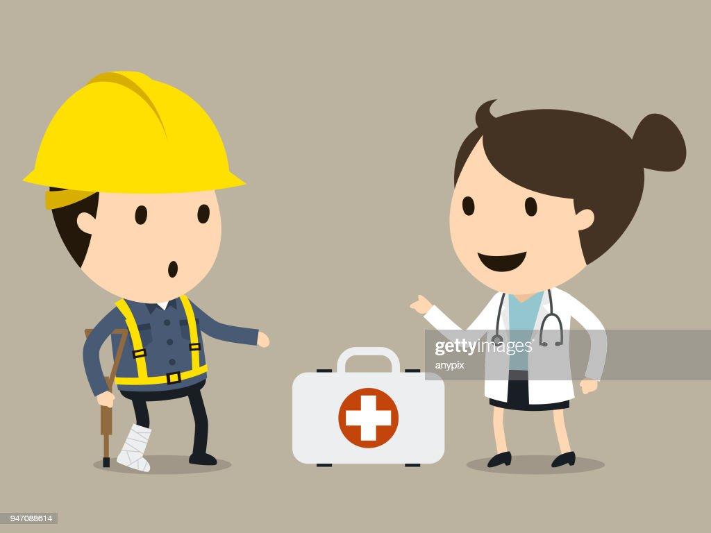 Doctor treats the worker