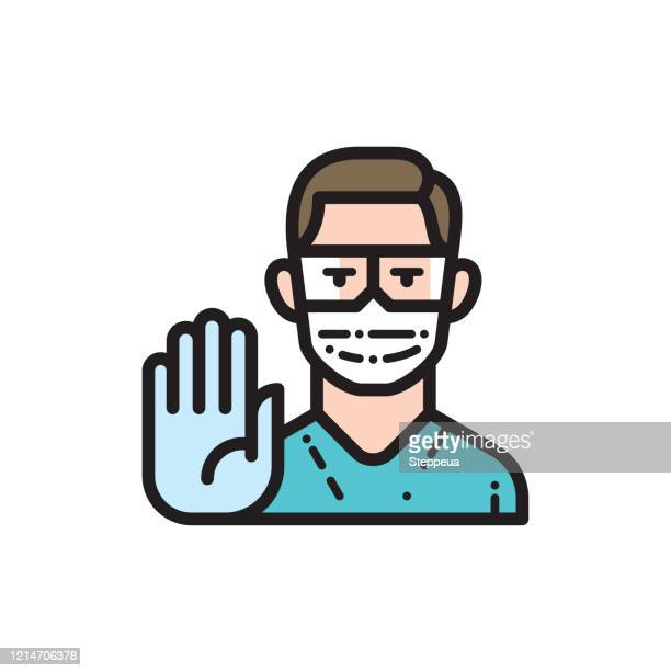 doctor wearing medical face mask and disposable gloves showing stop gesture - glove stock illustrations