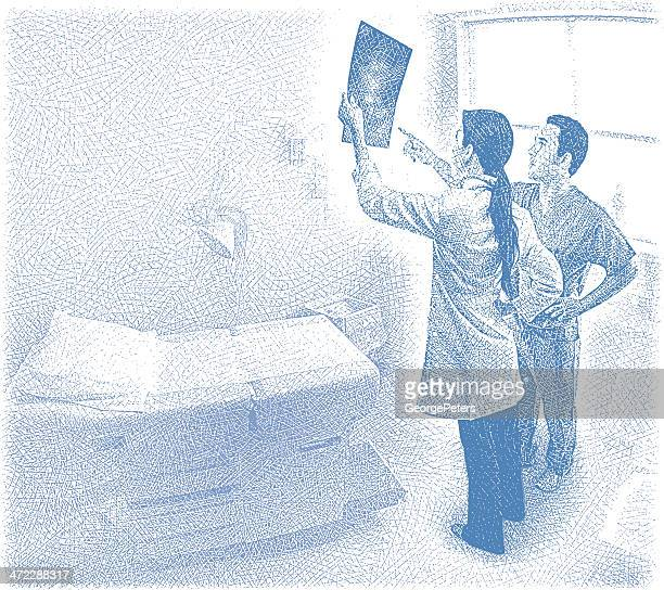 Doctors Viewing X-Ray