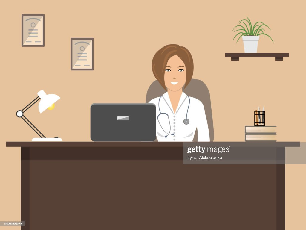Doctor's workplace. A female doctor in a white coat is sitting at the table