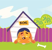 Dog sleeping in doghouse