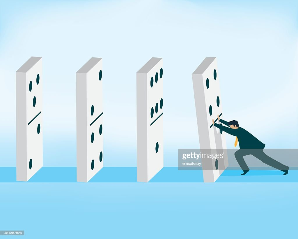 Domino effect, businessman pushing domino piece