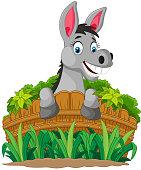 Donkey cartoon holding fence
