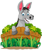 Donkey cartoon holding fence