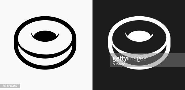 donut icon on black and white vector backgrounds - glazed food stock illustrations, clip art, cartoons, & icons