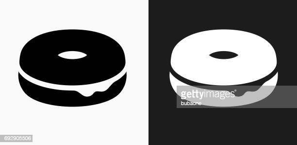 Donut Icon on Black and White Vector Backgrounds