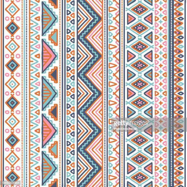 doodle tribal pattern in pastel color - indigenous culture stock illustrations