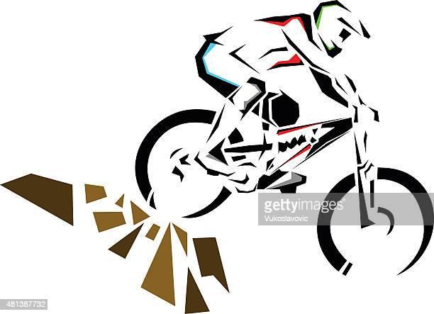 Downhill mountain biker riding down the rocks.