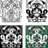 Dragons entwined in traditional celtic ornaments