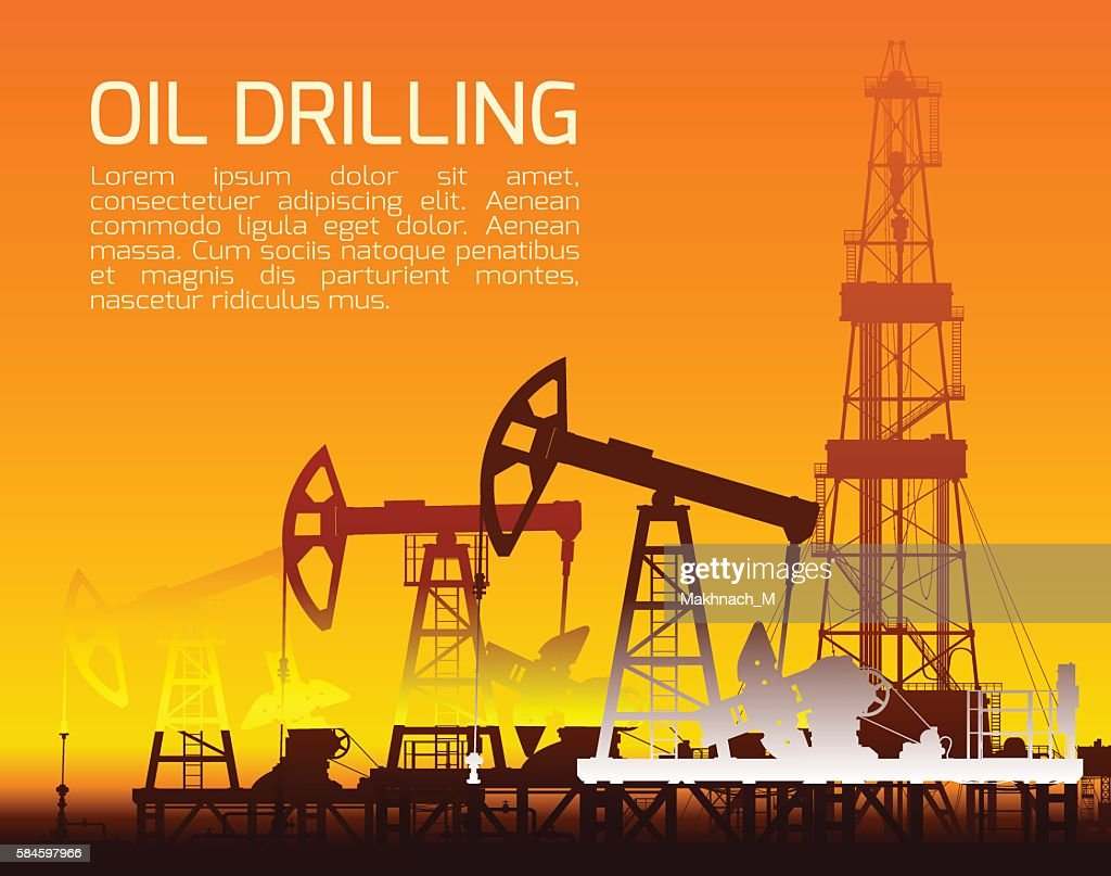 Drilling rigs and oil pumps at sunset