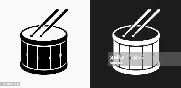 drum and drumsticks icon on black and white vector backgrounds - percussion instrument stock illustrations