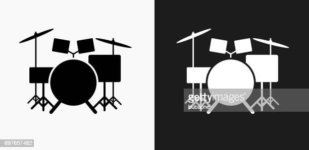 drums instrument icon on black and white vector backgrounds - drum kit stock illustrations