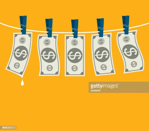 Drying dollars hanging on a clothesline