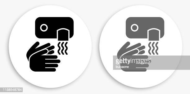 drying hands black and white round icon - währung stock illustrations
