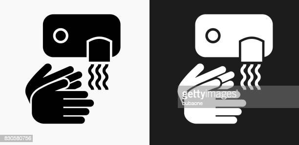 drying hands icon on black and white vector backgrounds - drying stock illustrations
