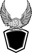 Eagle bird on blank shield. Design element for emblem, sign, badge.