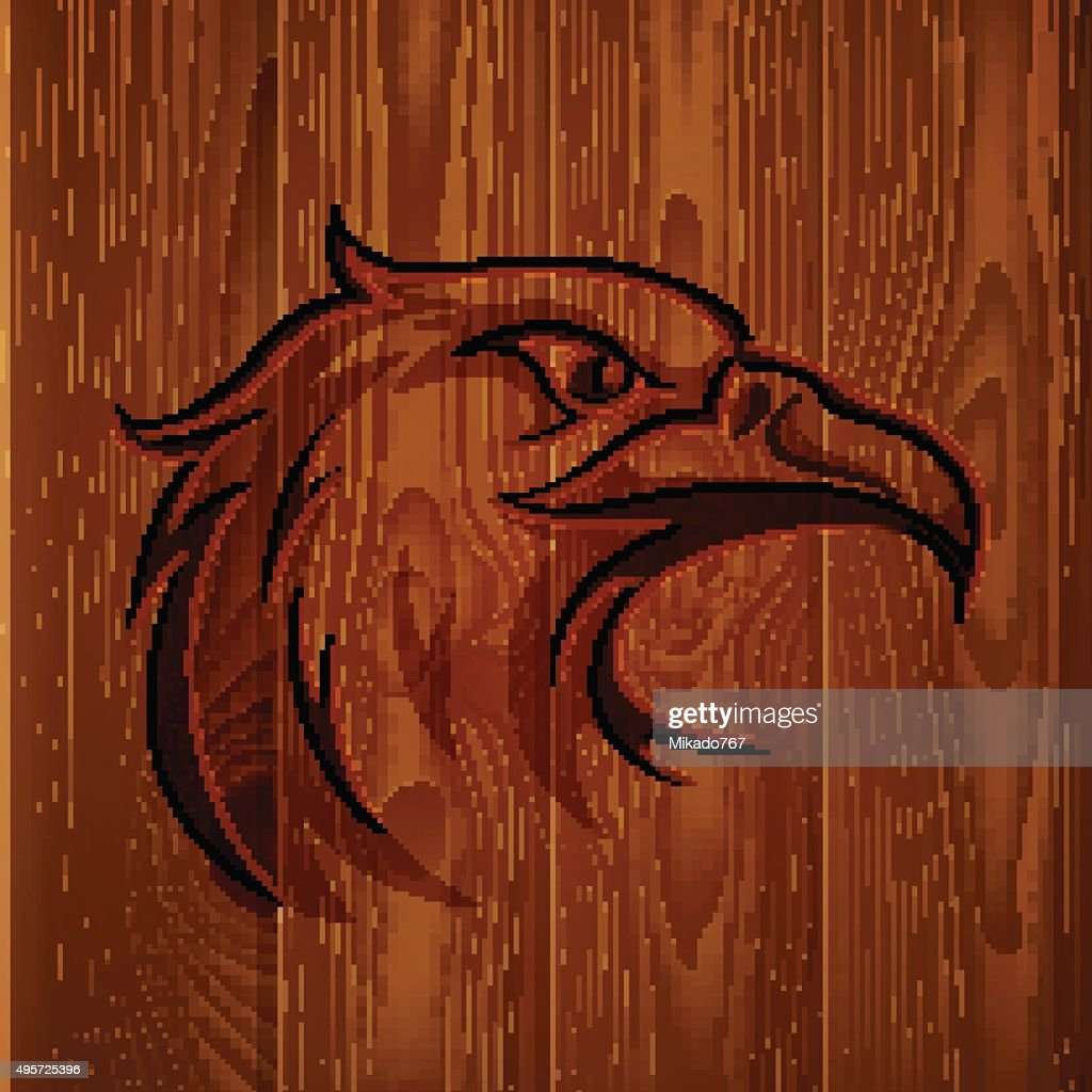 Eagle head vintage logo on realistic brown wood boards texture