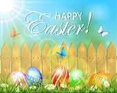 Easter background with fence and eggs