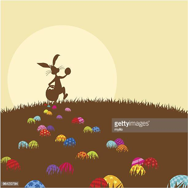 easter bunny and easteregg painted in chocolate color - easter bunny stock illustrations