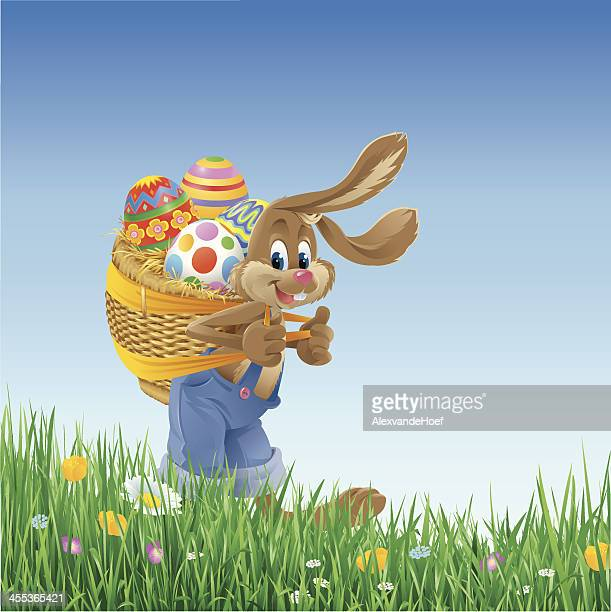 easter bunny carrying basket with eggs - easter bunny stock illustrations, clip art, cartoons, & icons