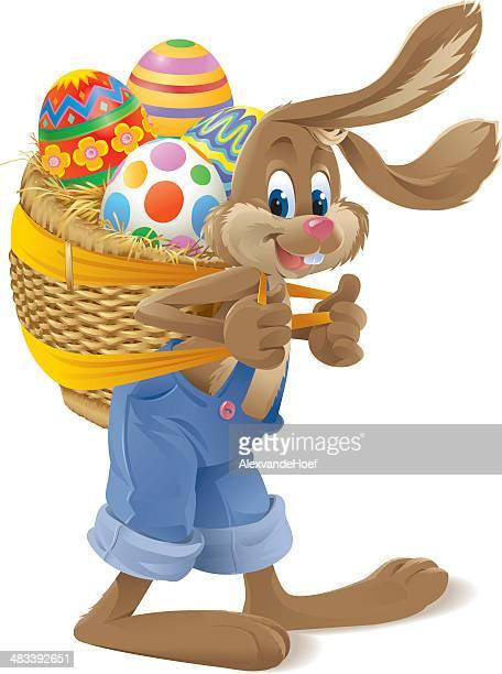 osterhase trägt einen korb mit eiern - osterhase stock-grafiken, -clipart, -cartoons und -symbole