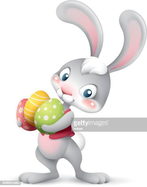 easter bunny holding pile of eggs - easter bunny stock illustrations